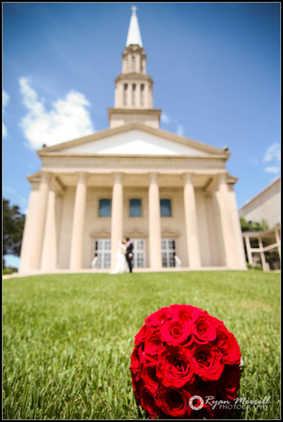 wedding church couple bride and groom flowers in front or church